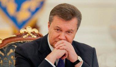 Рядом с Януковичем нельзя находиться с мобильным телефоном или сумкой